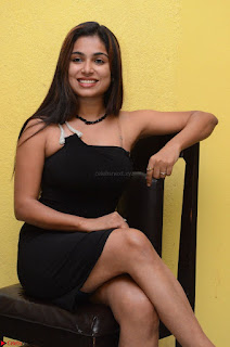 Vrushali Gosavi in strapless Short Black Dress At Follow Follow U Audio Launch 027.JPG