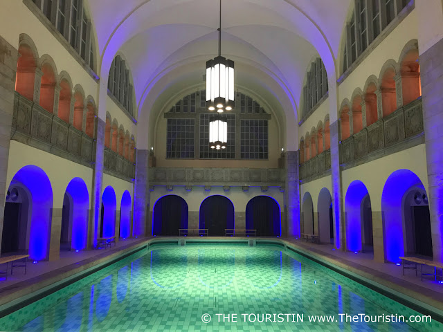 Swimming pool illuminated with green and blue light.