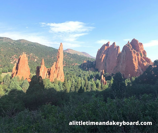 Distinctive rock formations rise above the evergreens.
