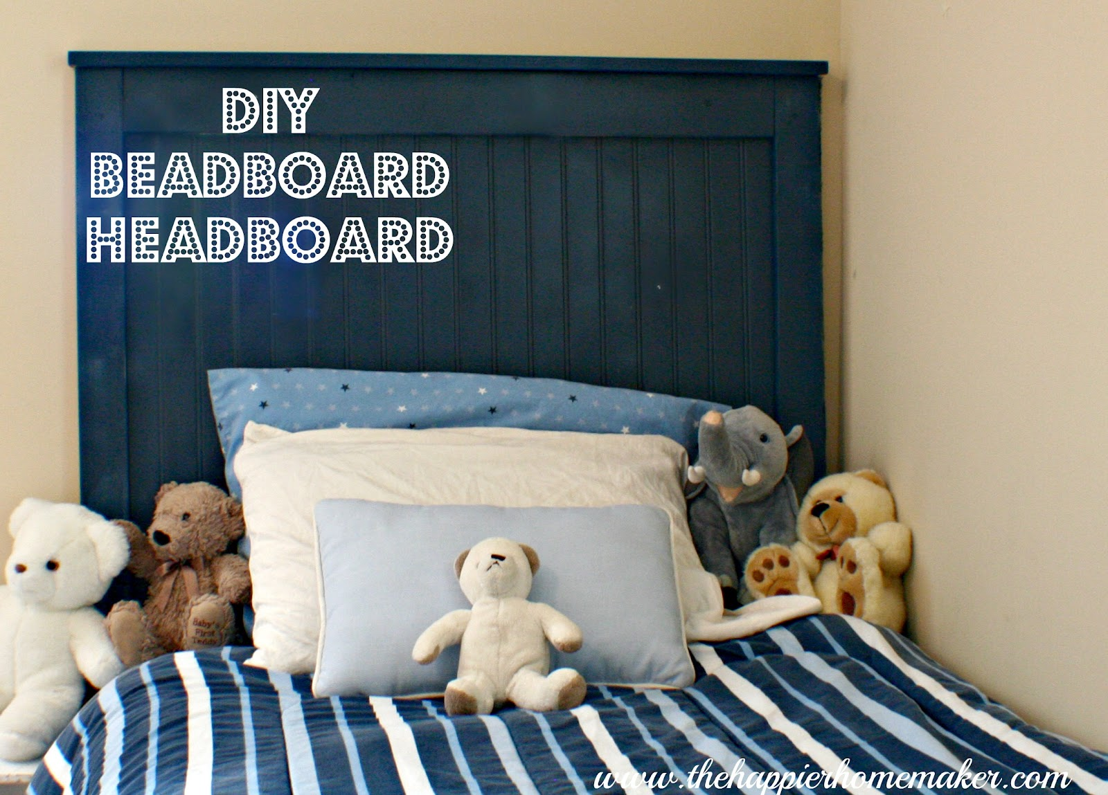 navy blue twin sized diy beadboard headboard with blue striped bedding and stuffed animals