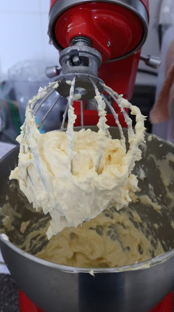 the buttercream on the whisk of the kitchen aid