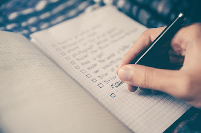 Writing a list of goals in a journal