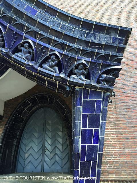 Porched entrance with dark blue glazed ceramic.
