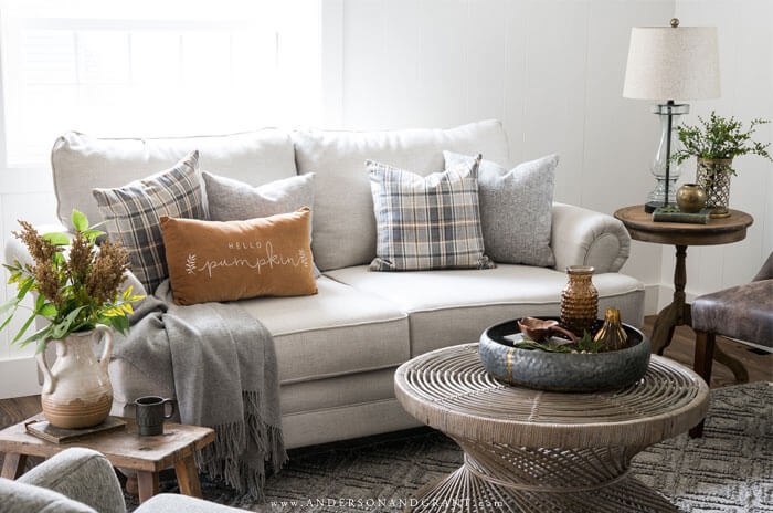This modern transitional living room is updated for fall with a gray blue and gold color scheme and decor.