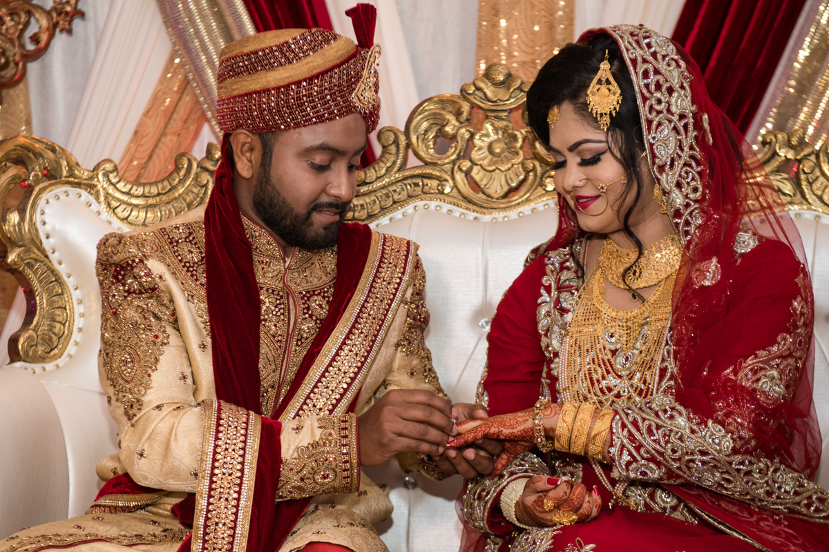 Beautiful Indian Couple Exchanging Wedding Rings.