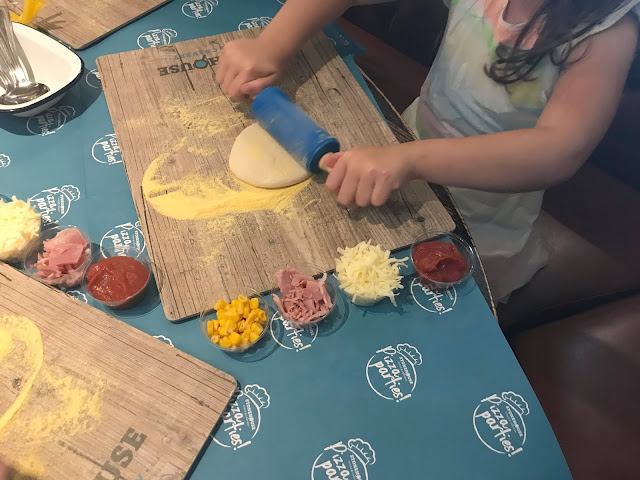 rolling dough for a pizza
