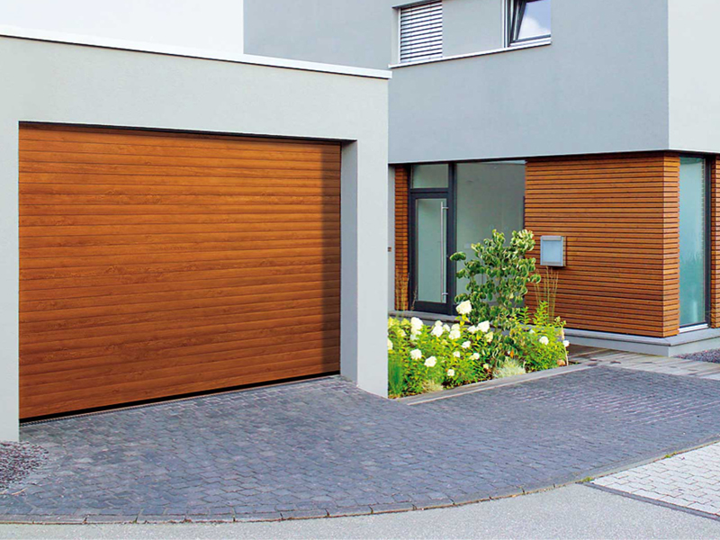 The GaraRoll roller garage door in Golden Oak timber effect