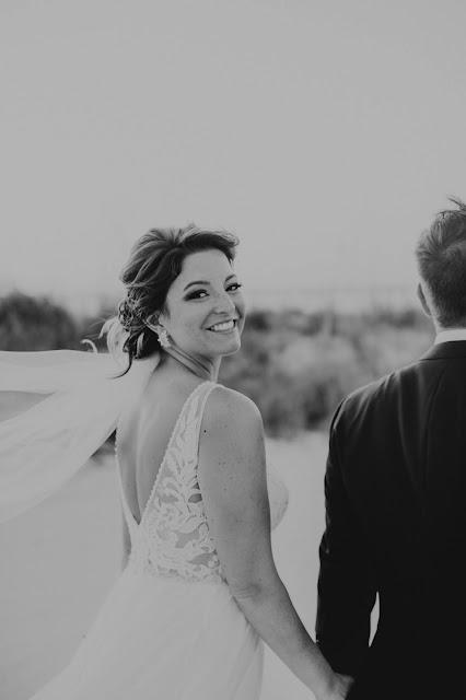 Black and white smiling bride photos.