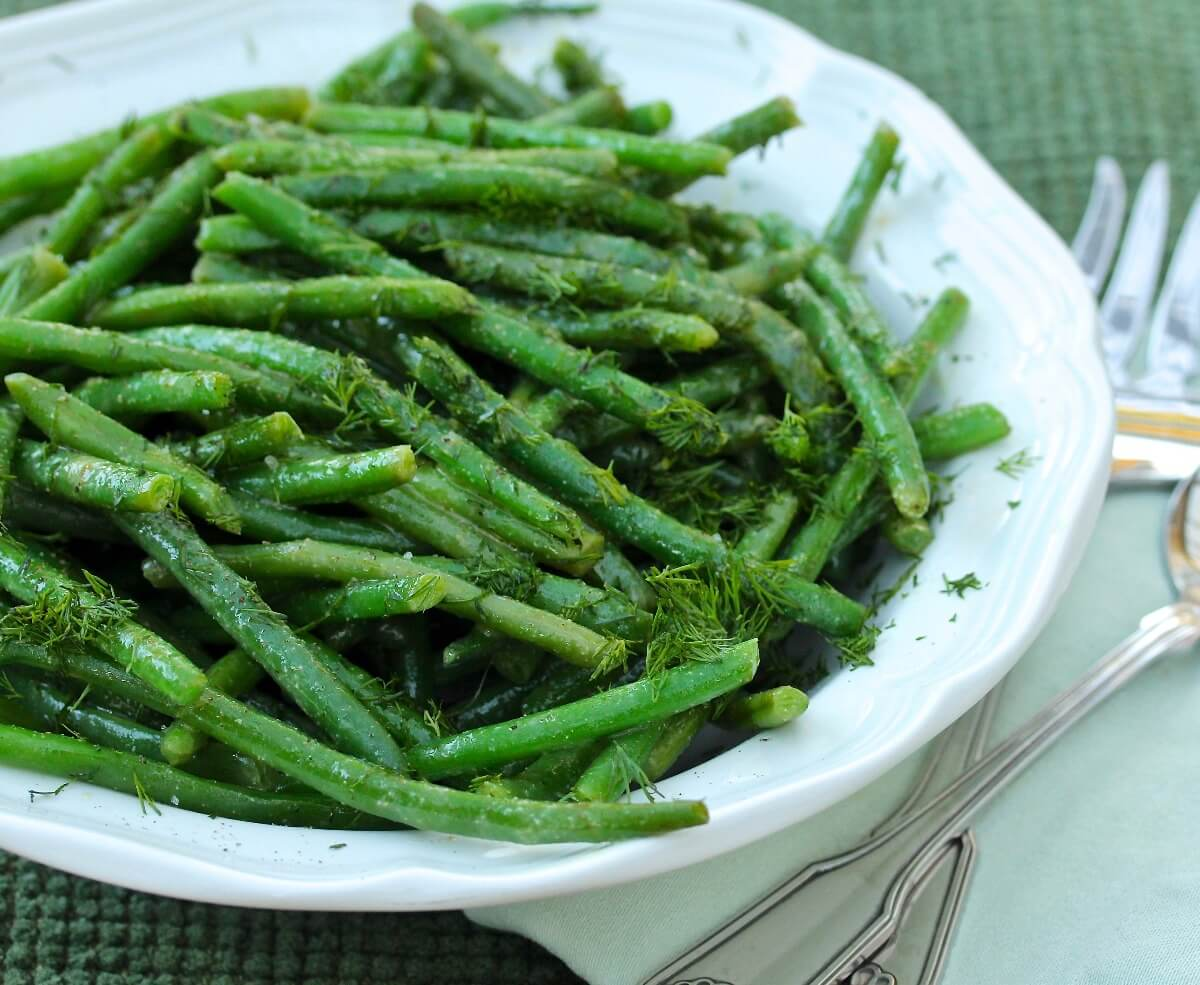 French Green Bean Salad with Dijon Vinaigrette and dill in a bowl.
