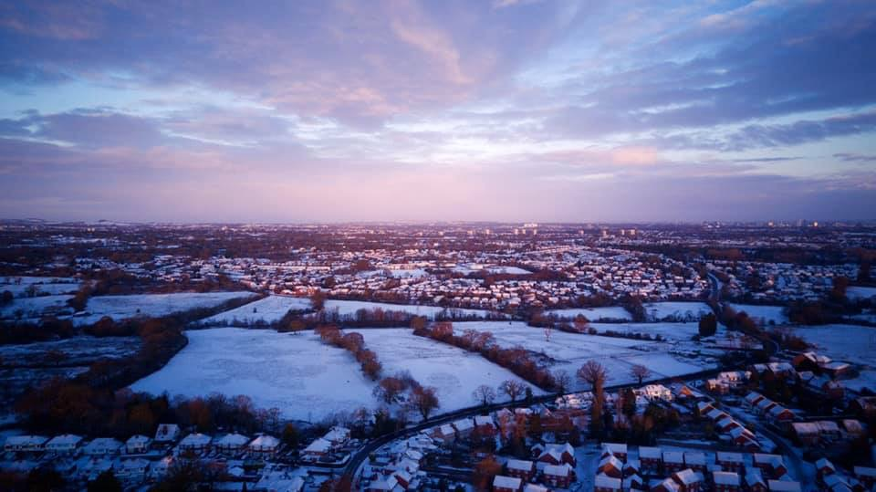 Aerial shot of the village Wythall covered in snow