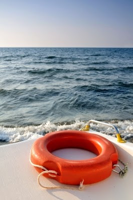 Image of a lifebuoy rescue ring. A very common personal floatation device. This article is about essential safety tips for your next trip on the water.
