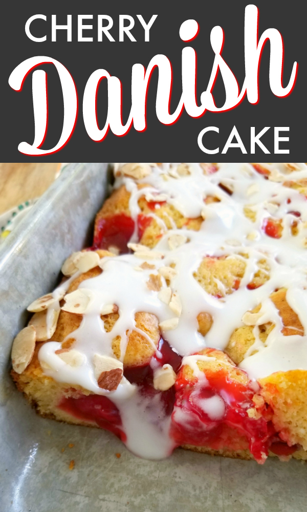 An easy semi-homemade cake recipe dotted with cherry pie filling, drizzled with sour cream icing and topped with slivered almonds.