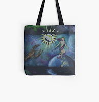 A tote bag featuring the Tarot cards The World and The Moon