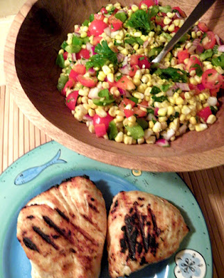 Plate of Grilled Halibut and Large Bowl Filled with Corn Tomato Salad