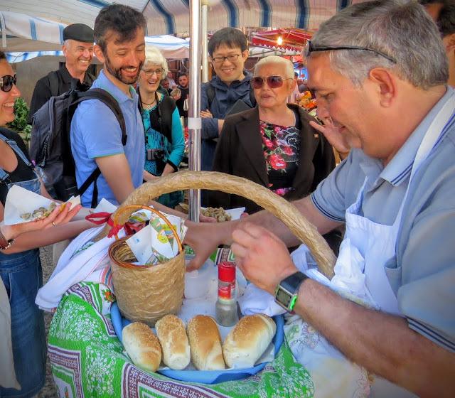 Sicilian Food - vendor serviing a 'A Frittula
