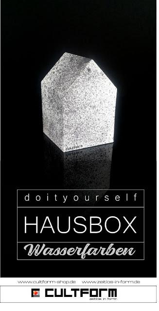 Die Hausbox von Cultform. Ein eindrucksvolles und doch einfaches DIY: kleine Geschenke individuell modern verpacken im aktuellen Watercolor-Trend: schwarzer Hintergrund, Hausbox schwarz.gesprenkelt, Pingrafik mit Text