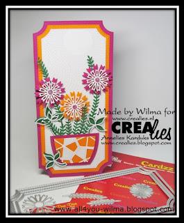 De slimeline-ticket-kaart met de versierde vaas met bloemen en enkele gebruikte stansen. The slimline ticket-card with the decorated vase with flowers and some used dies.