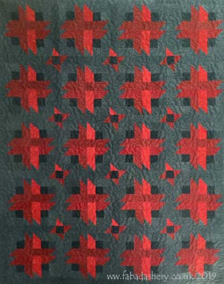 'Firestorm' quilt designed by Bonnie Sullivan, made by Valerie,  Quilted by Fabadashery Longarm Quilting