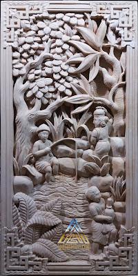 Relief batu alam paras putih motif sedang memancing ikan