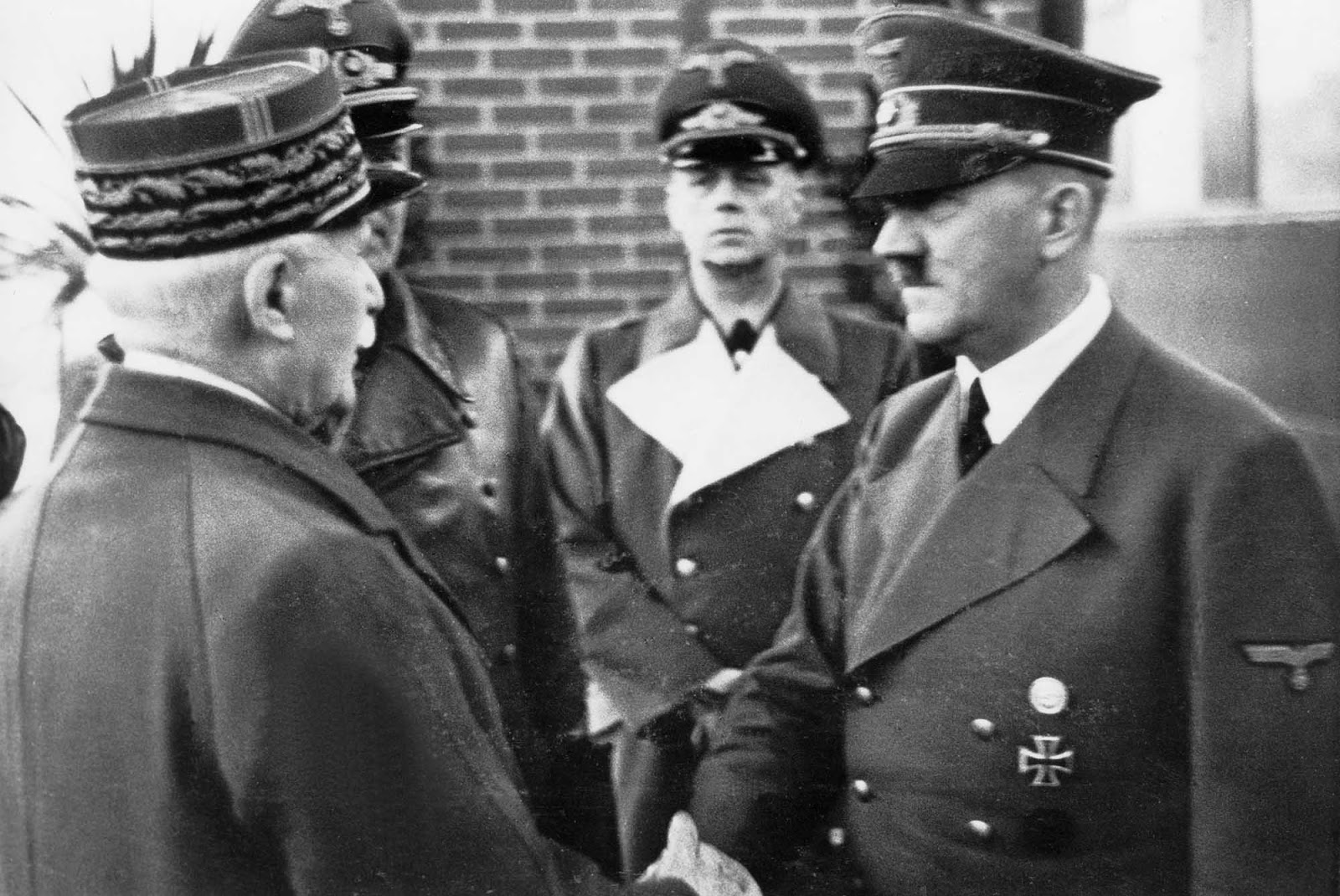 Unfortunately the image of him shaking hands with Hitler came to represent a view that he was engaged in collaboration with the Nazi's, rather than a more pragmatic co-operation. It became evidence to portray him as a traitor to France.