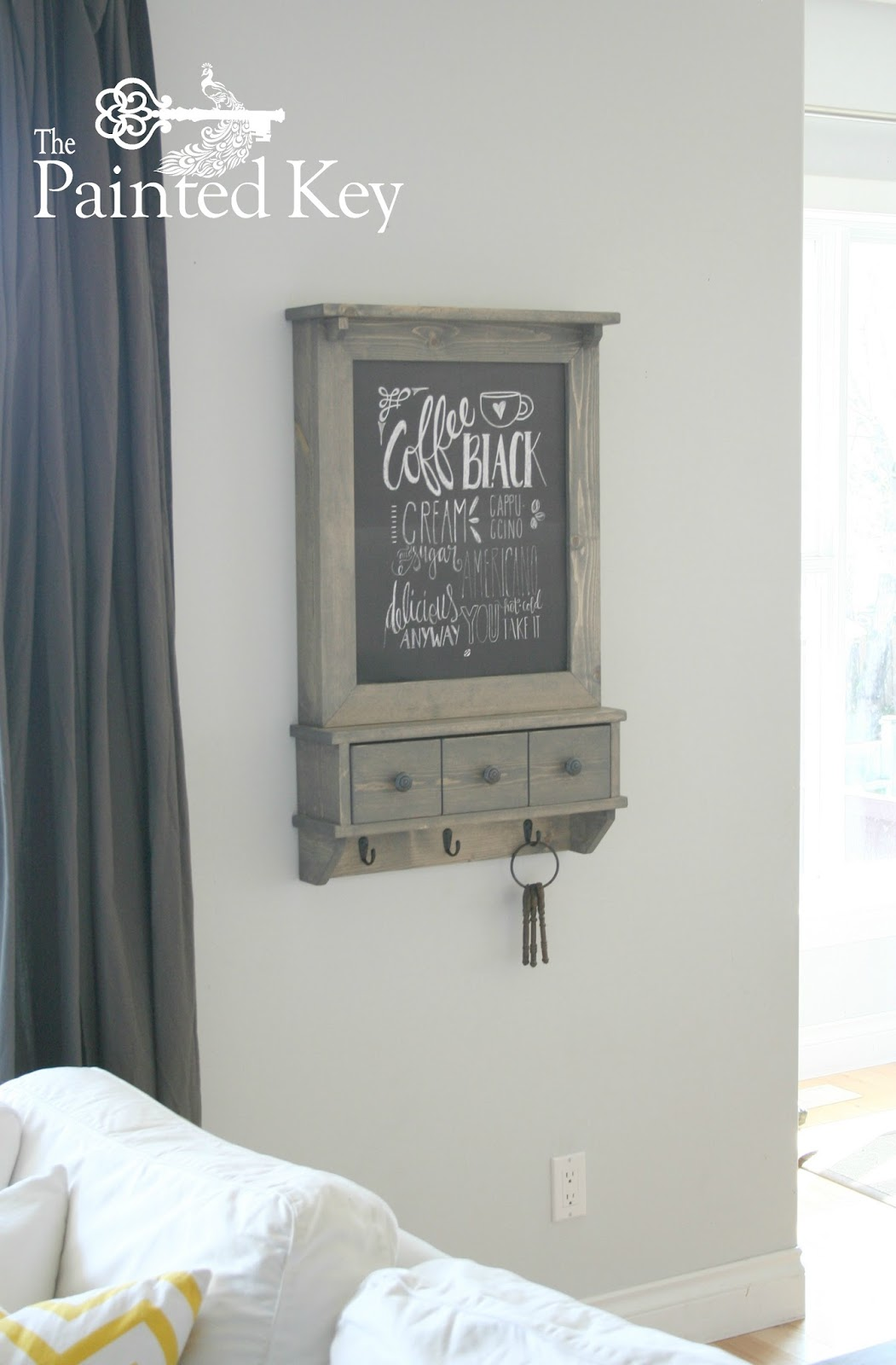 The Painted Key: Hidden Storage Cabinet
