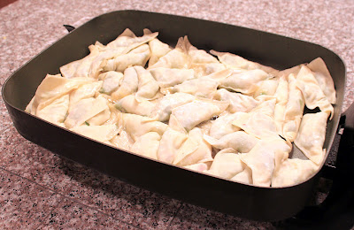 how many potstickers can i place in 1 pan