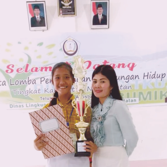 Dian Natalia Magdalena Dachi Juara 1 Lomba Puisi Ekologi Tingkat Kabupaten Nisel