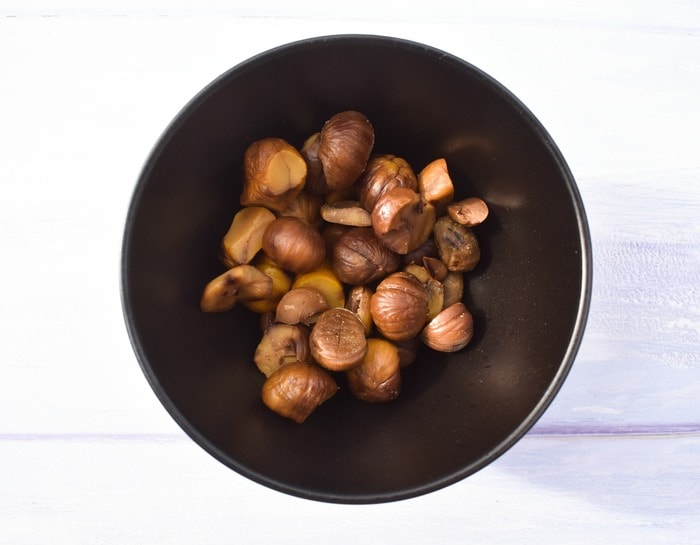 cooked chestnuts in a black bowl