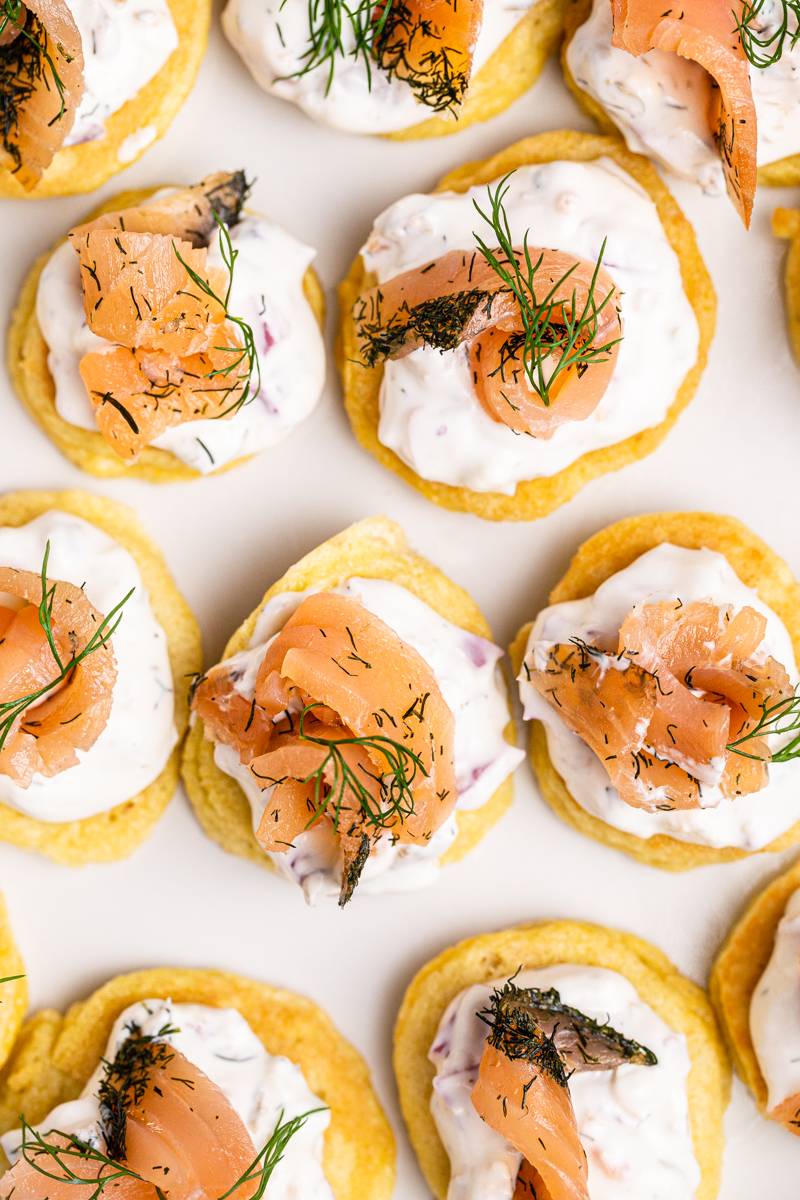 Overhead photo of Keto Blinis with Smoked Salmon Pate on a white platter.