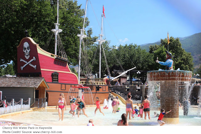 a red pirate ship surrounded by children playing in the water