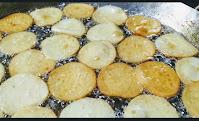 Light brown Malpua frying in ghee