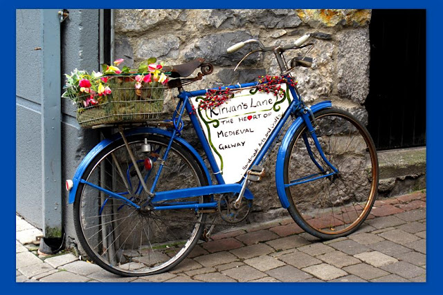 another bicycle  with flowers basket at the back
