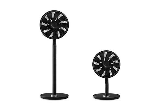 A black pedestal and desktop fan side by side