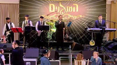 "Shloime Gertner interpretando ""Nishmath"" junto a la Banda Kumzits. ¡Disfruta y compártelo!."