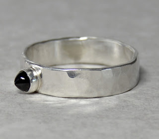 http://brackendesigns.com/product/size-8%C2%BD-unique-sterling-silver-and-garnet-band-ring
