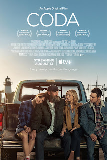 The movie poster for the film CODA, which pictures the 4 stars sitting on the back of a pickup truck
