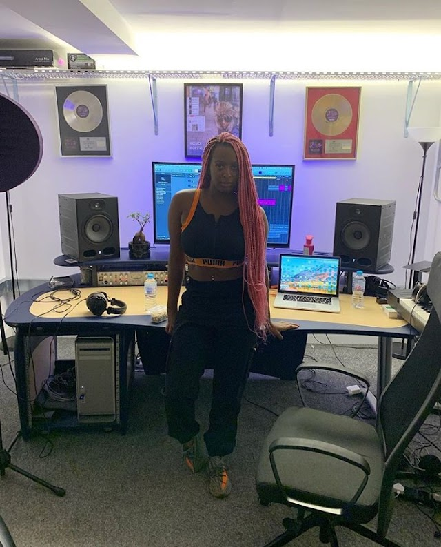 DJ Cuppy photographed in studio while working on a new song