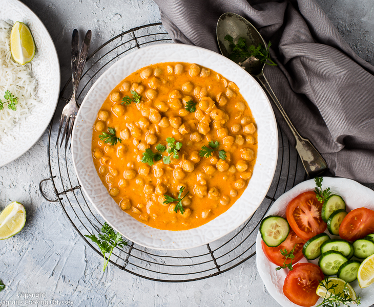 image of chickpea curry served with rice and salad