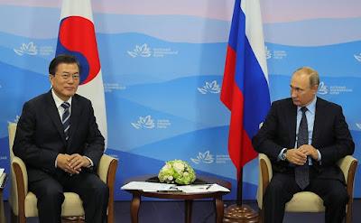 Vladimir Putin with President of South Korea Moon Jae-in in Vladivostok.