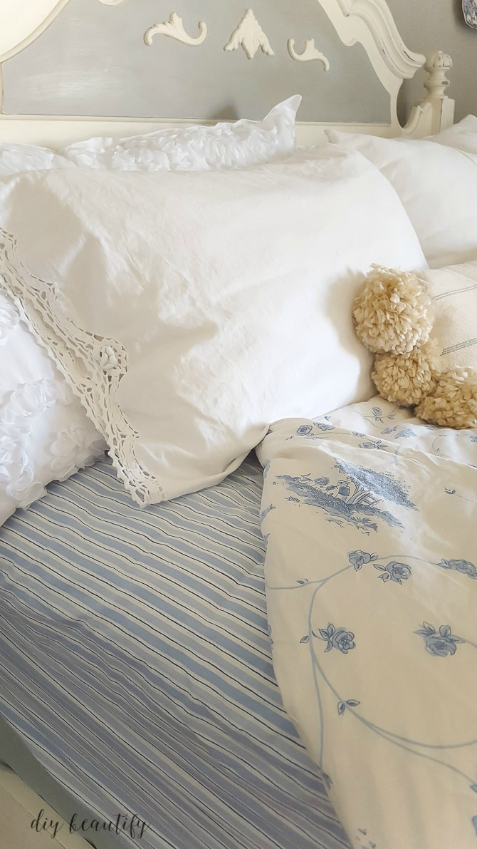 A guest bedroom mini makeover with blue and white for a fresh take on a farmhouse bedroom. Come find all the details at diy beautify!