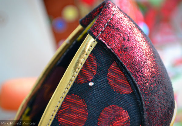 close up of red fabric and gold metallic edge to shoe