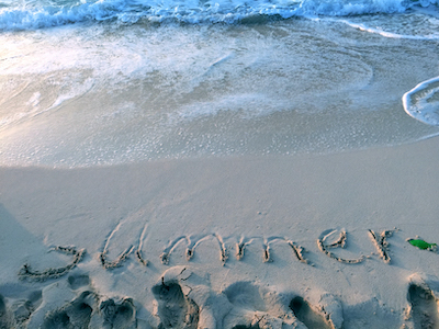 Sand beach with summer text stock image