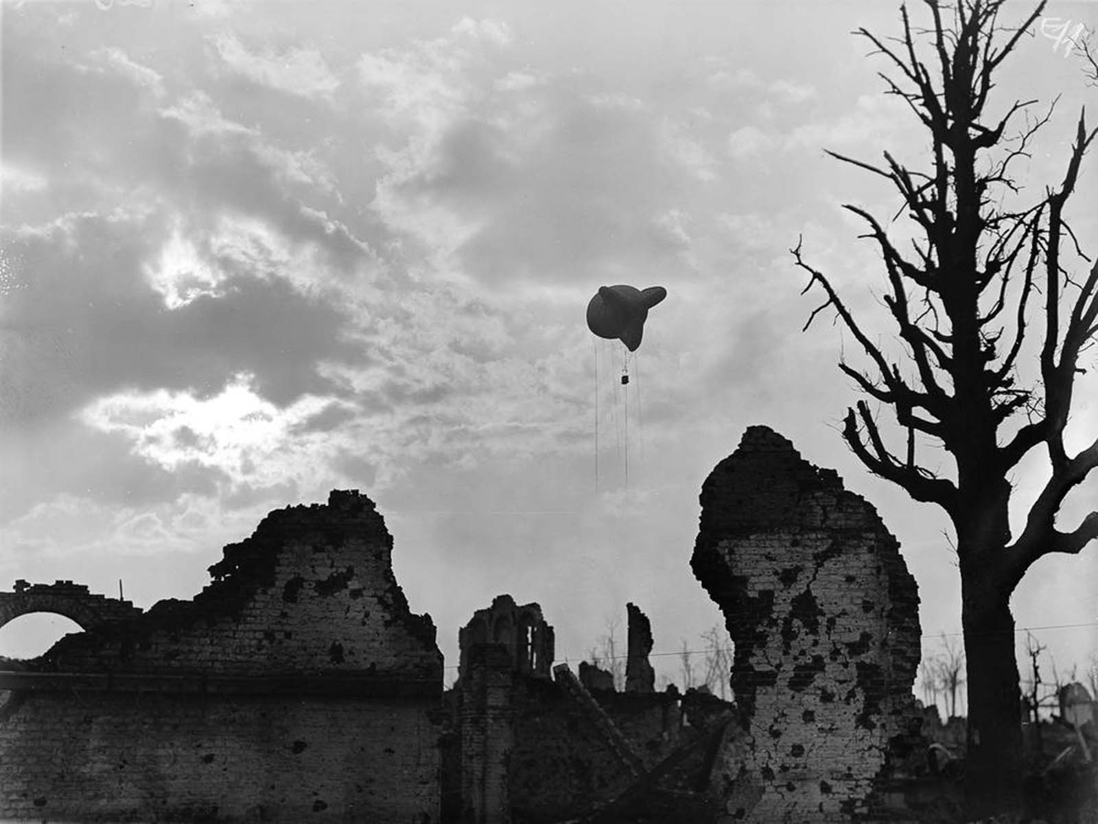 An observation balloon above the ruins of Ypres, Belgium. 1917.