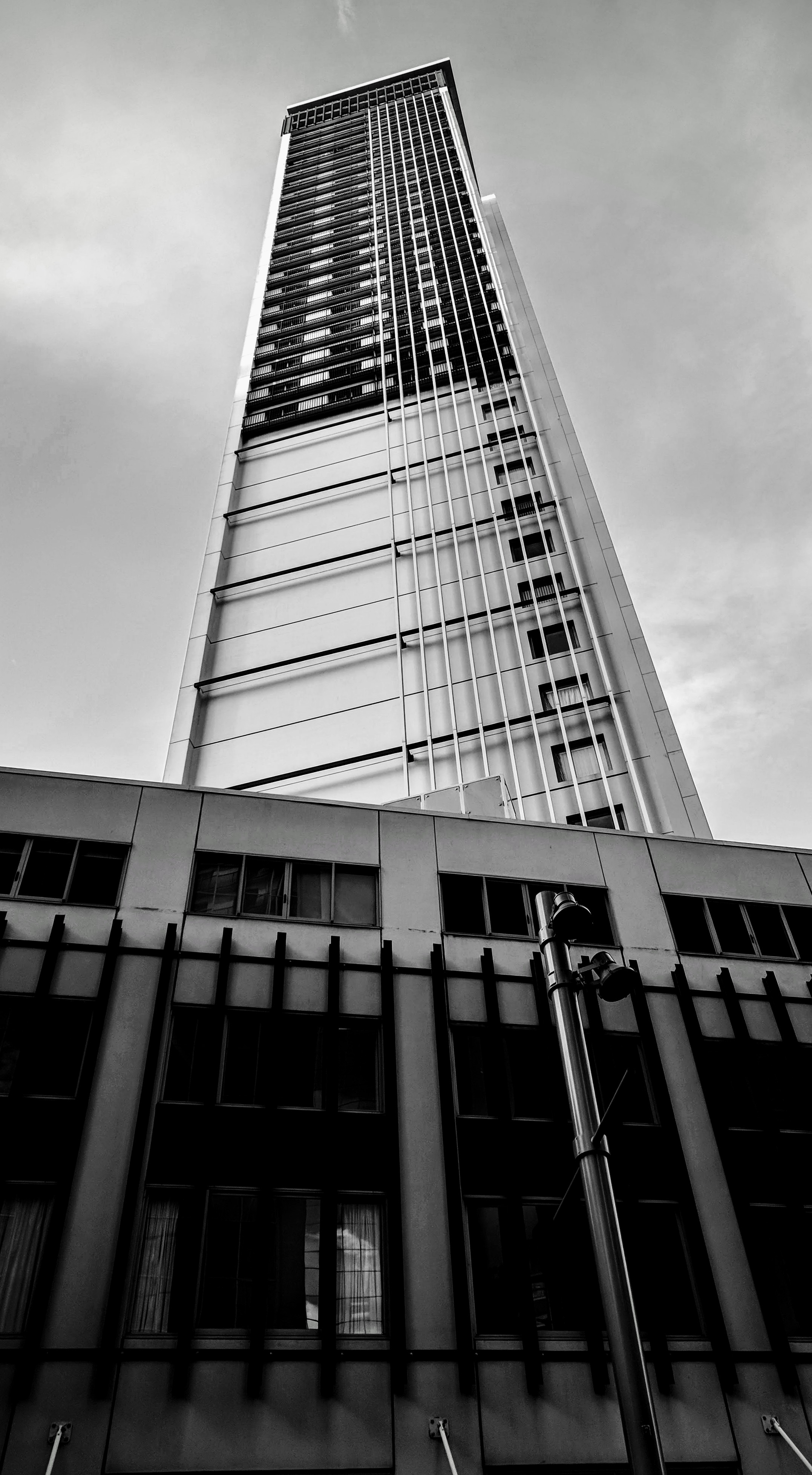 Black and White photograph of a tall Central Auckland hotel in 2018