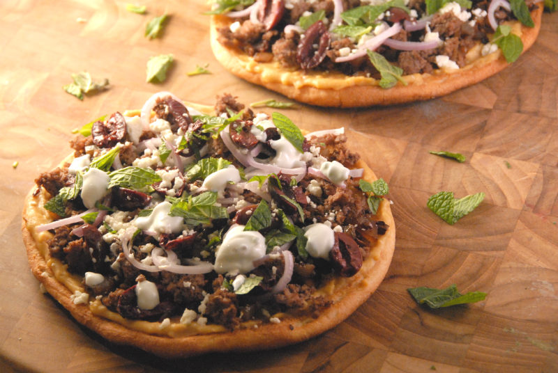 Personal Greek style pizzas hummus ground meat