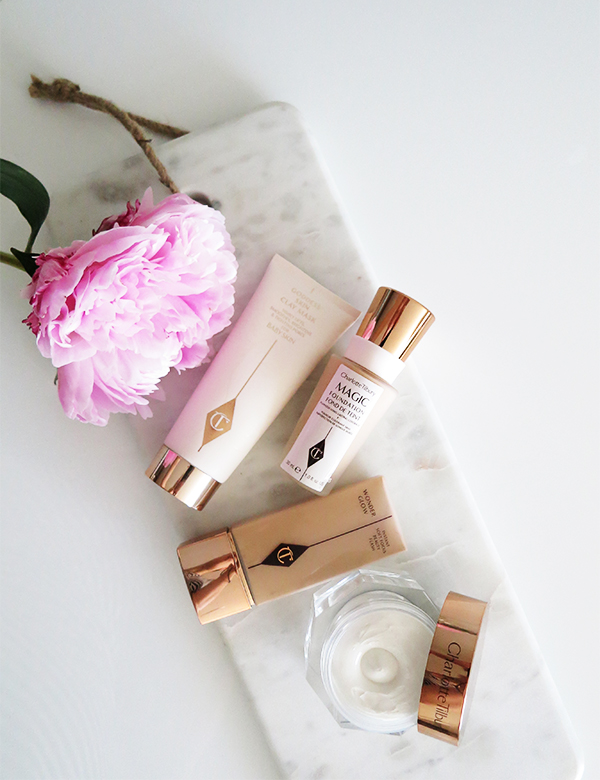 Charlotte Tilbury's foundations and skincare give you a glowy complexion. From left to right: Goddess Skin Clay Mask, Magic Foundation in 5 Medium, Wonder Glow, Magic Cream.