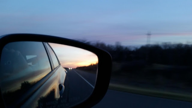 sunset in rear view mirror