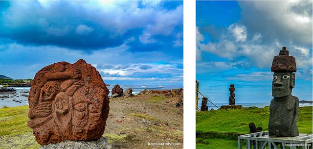 Escultura ritual e um moai restaurado à sua aparência original na vila de Hanga Roa