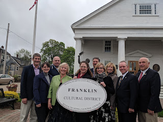 group photo with new sign at Franklin's official Cultural District dedication ceremony
