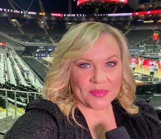Holly Rowe clicking selfie